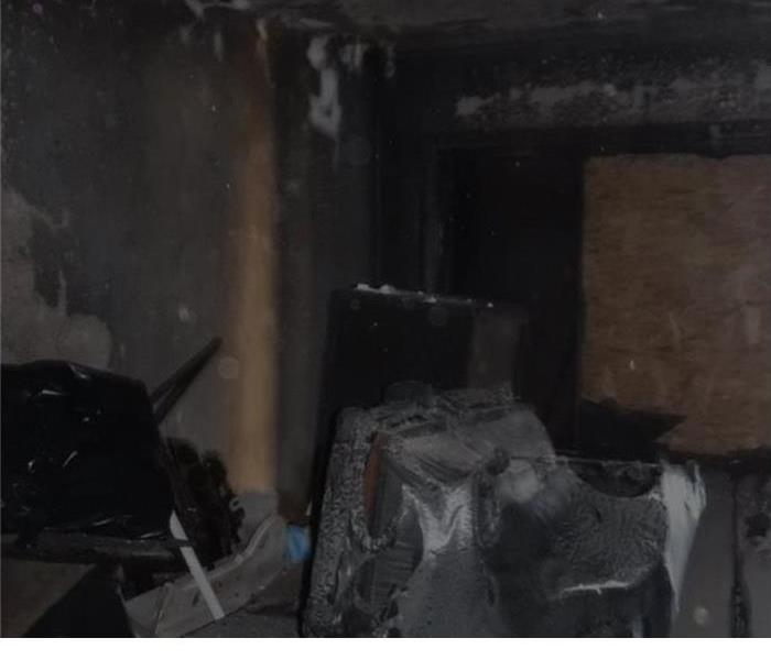 living room with burned up furniture and melted plastic