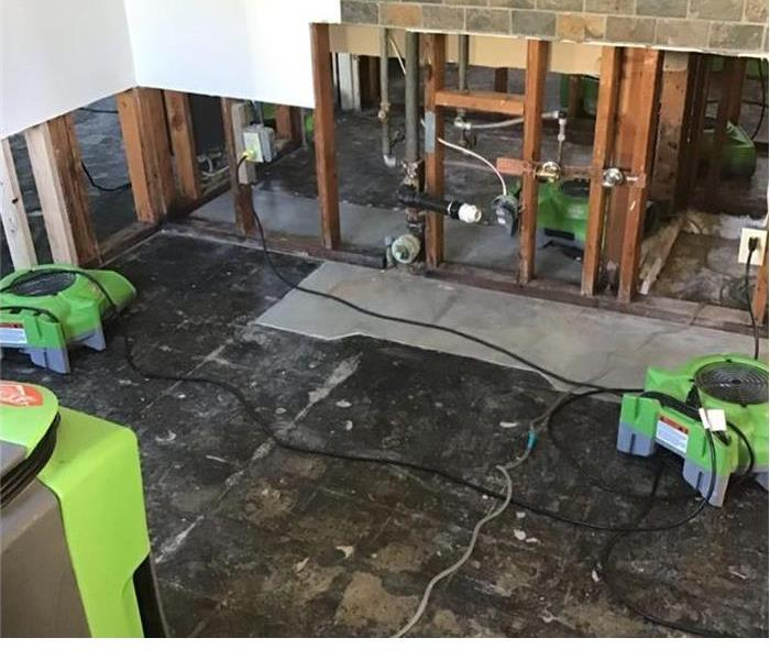 empty room with green machines around the floor